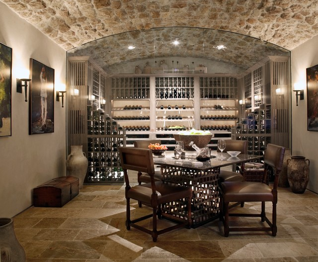 Antique tuscan wall cladding mediterranean wine cellar for Wine cellar design ideas and pictures