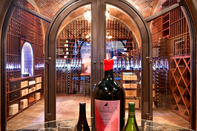 Arched Classic Mahogany Glass Enclosed Wine Cellar traditional-wine-cellar