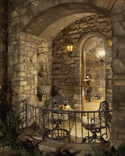 Awe-Inspiring Custom Italian Villa Stone House - Coronado Manufactured Stone mediterranean-wine-cellar