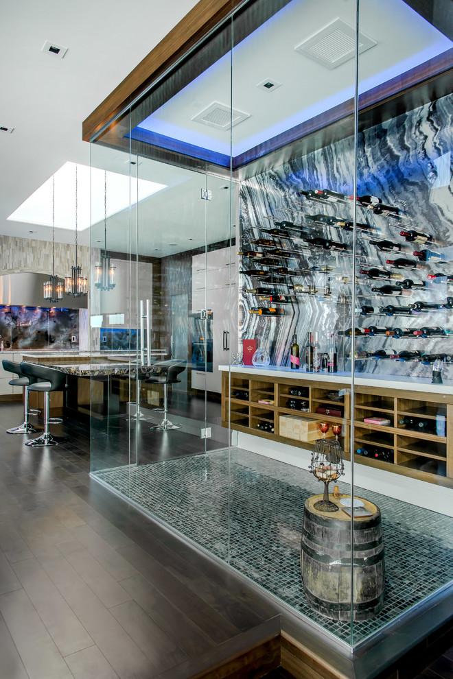 Wine cellar - large contemporary ceramic tile wine cellar idea in Edmonton with display racks