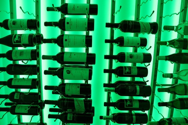 Beautiful Collection of Wine in Green Light contemporary-wine-cellar