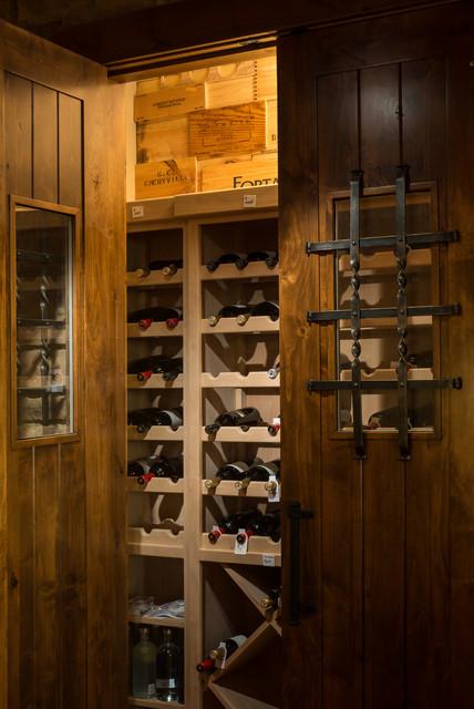 Brasada Ranch home design single story  with media room over garage rustic-wine-cellar