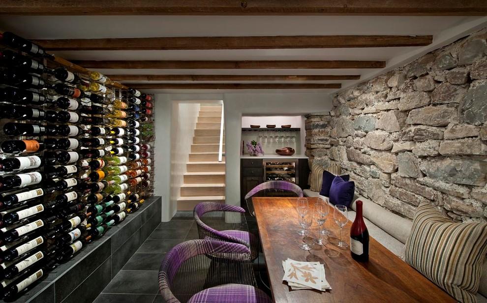 Wine cellar - southwestern slate floor and black floor wine cellar idea in Albuquerque with display racks