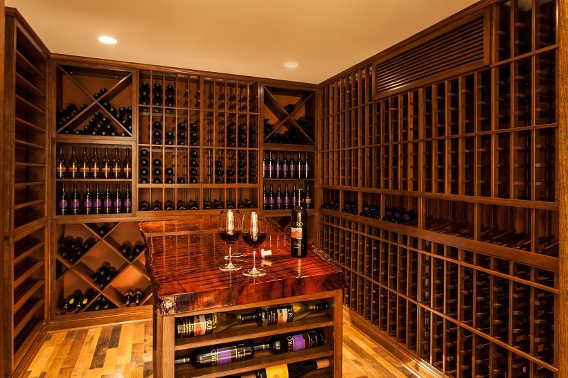 Inspiration for a large timeless light wood floor and yellow floor wine cellar remodel in Boston with storage racks