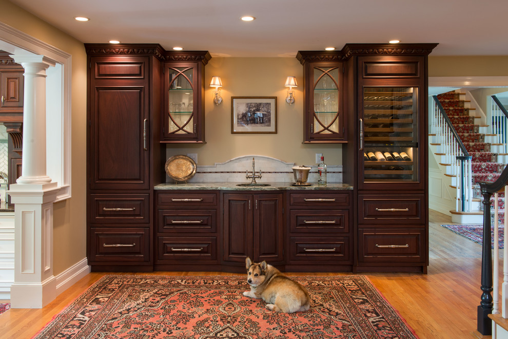Example of a mid-sized classic light wood floor and brown floor wine cellar design in Boston with display racks