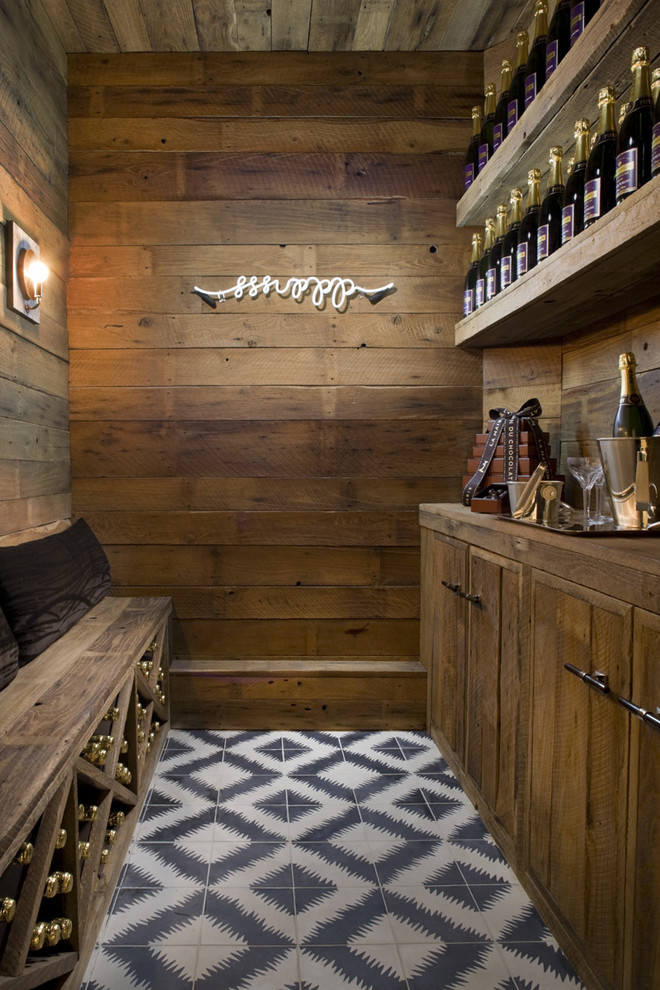 Inspiration for a rustic multicolored floor wine cellar remodel in San Francisco with diamond bins