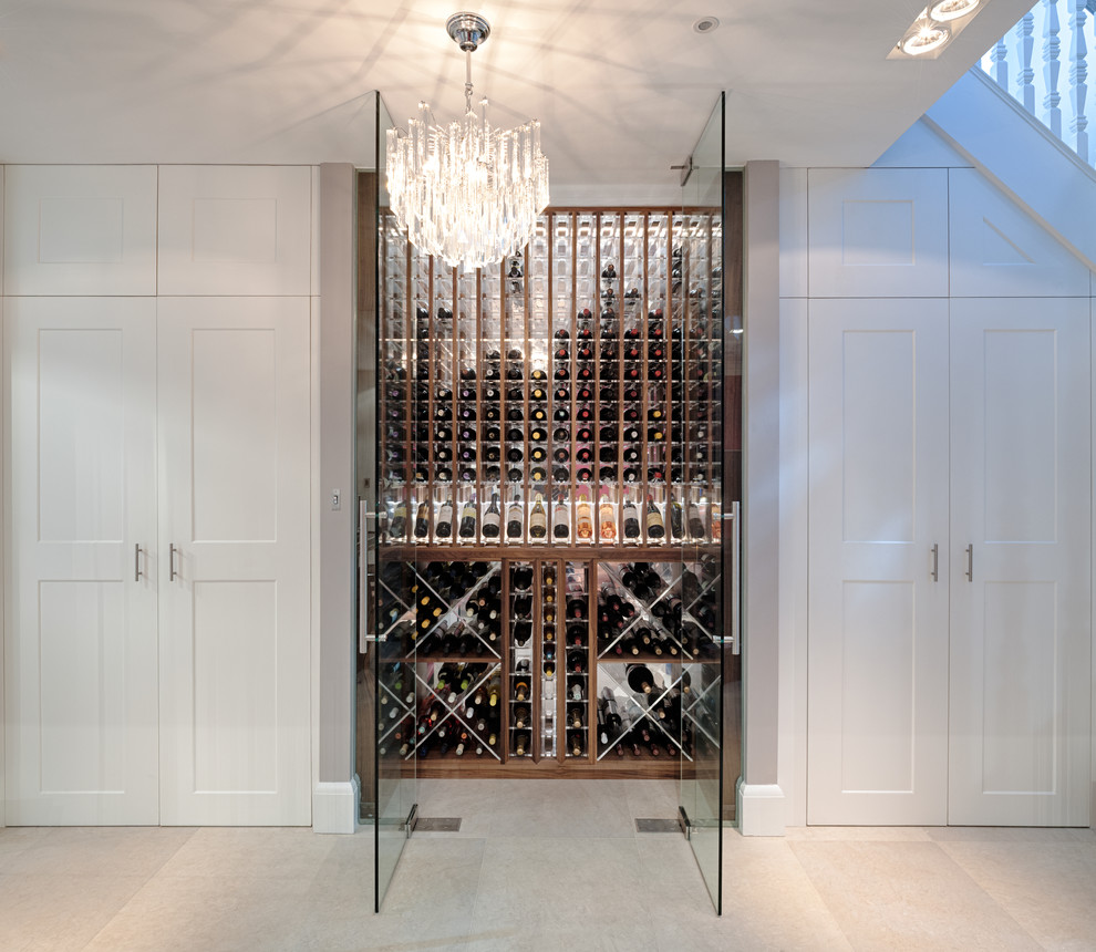 Example of a small trendy wine cellar design in London with storage racks