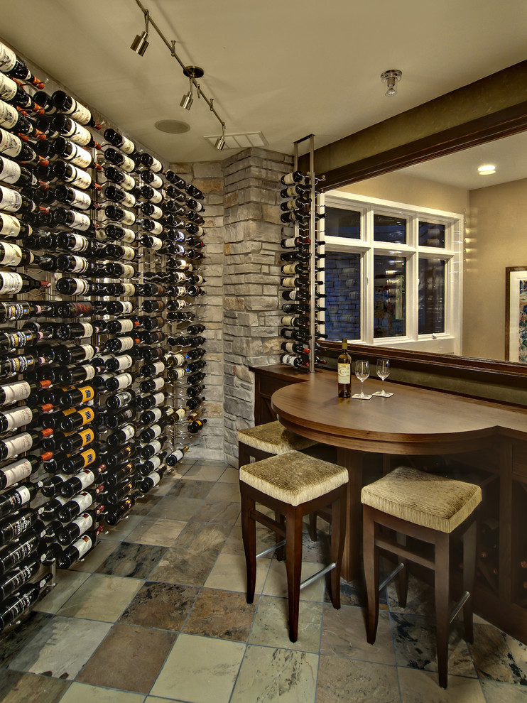 Inspiration for a timeless multicolored floor wine cellar remodel in Minneapolis with display racks