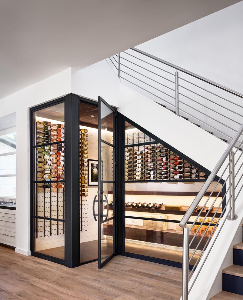 Example of a trendy beige floor wine cellar design in Austin with display racks