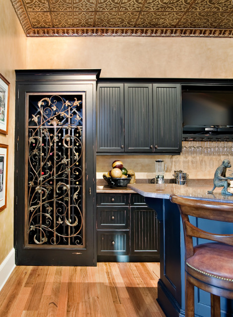 Custom bar with wrought iron cellar door traditional - Wrought iron kitchen cabinet door inserts ...