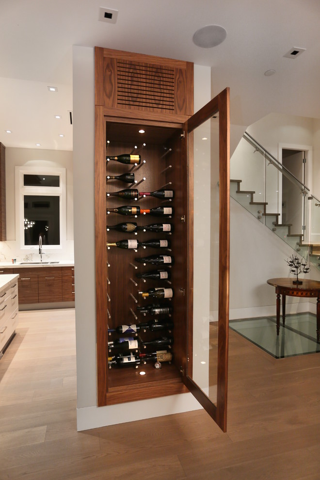 Example of a mid-sized trendy medium tone wood floor wine cellar design in Vancouver