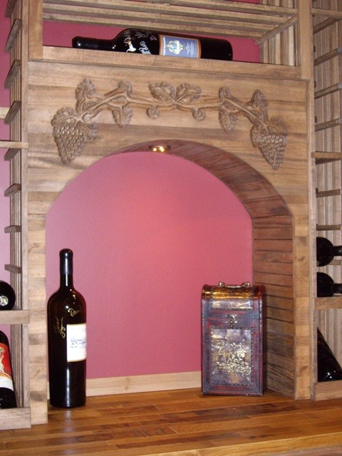 Decorative Arch Doubles as a Wine Tasting/Display Area traditional-wine-cellar