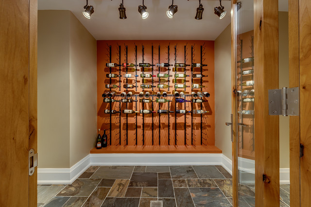 Transitional wine cellar photo in Toronto with storage racks