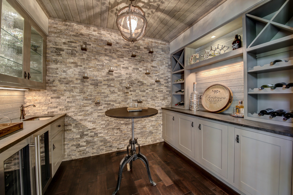 Example of a large transitional dark wood floor and brown floor wine cellar design in Dallas with storage racks