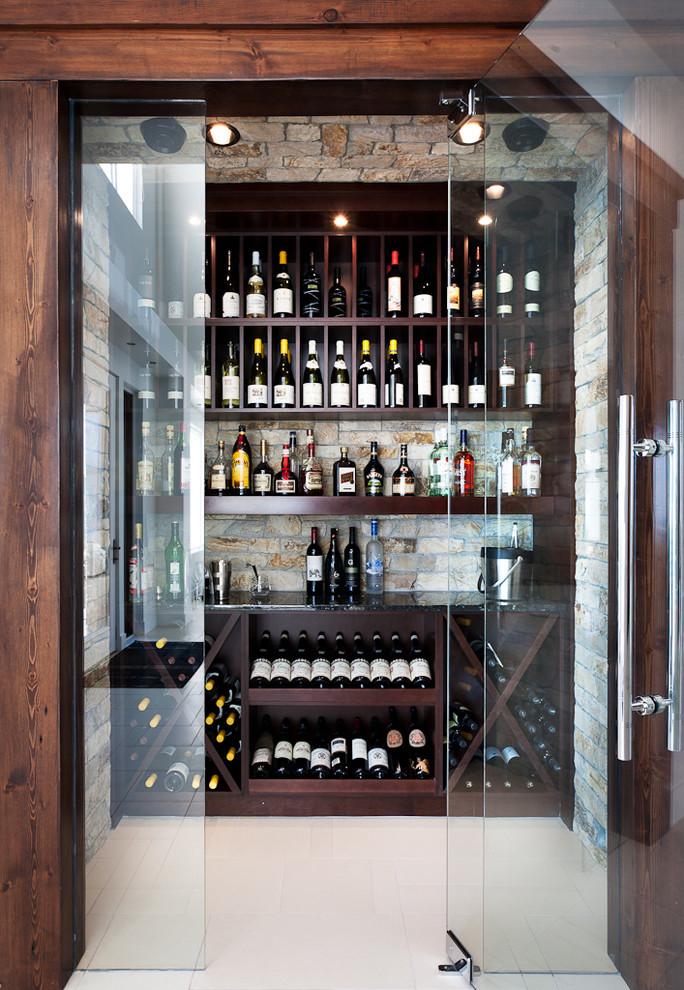 Wine cellar - contemporary white floor wine cellar idea in Vancouver with display racks