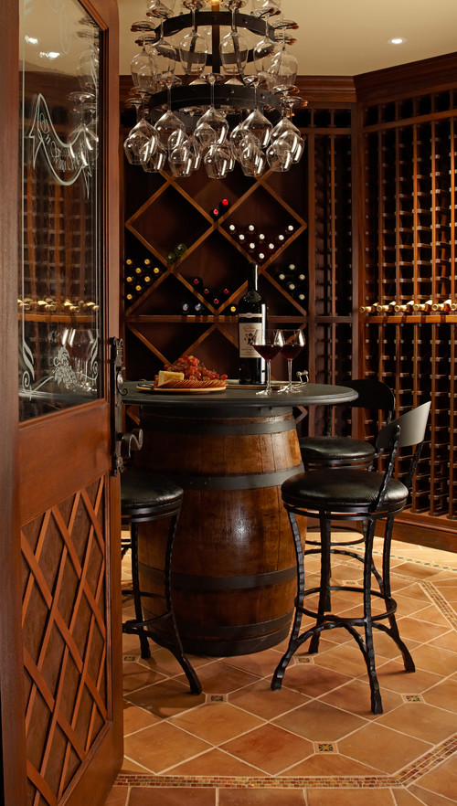 This wine cellar featuring a round pub table with four stools, making it the center of the wine cellar