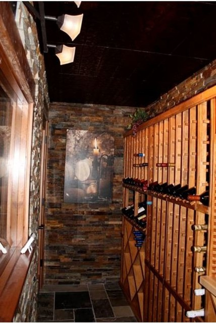 Hamann Custom Basement Design Finish - traditional - wine cellar