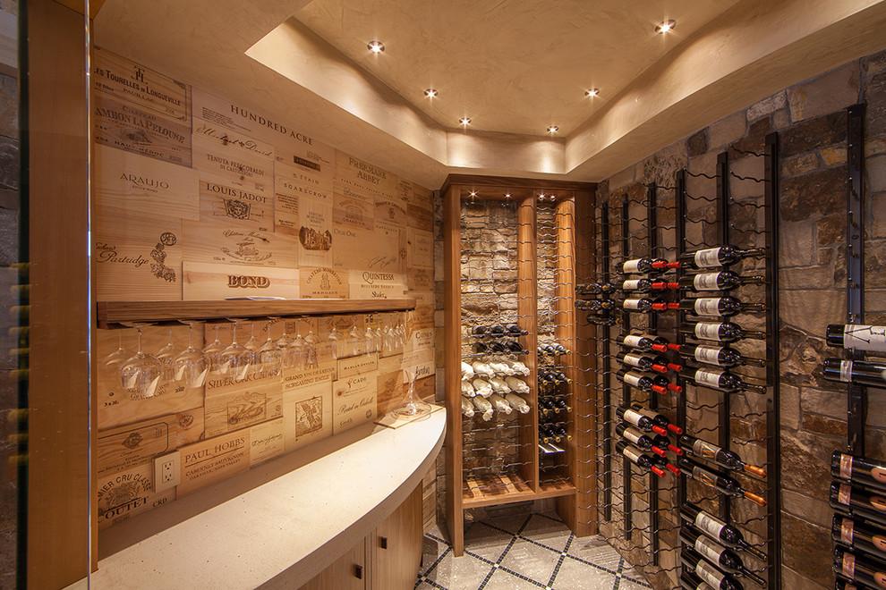 Wine cellar - mediterranean wine cellar idea in Denver with storage racks