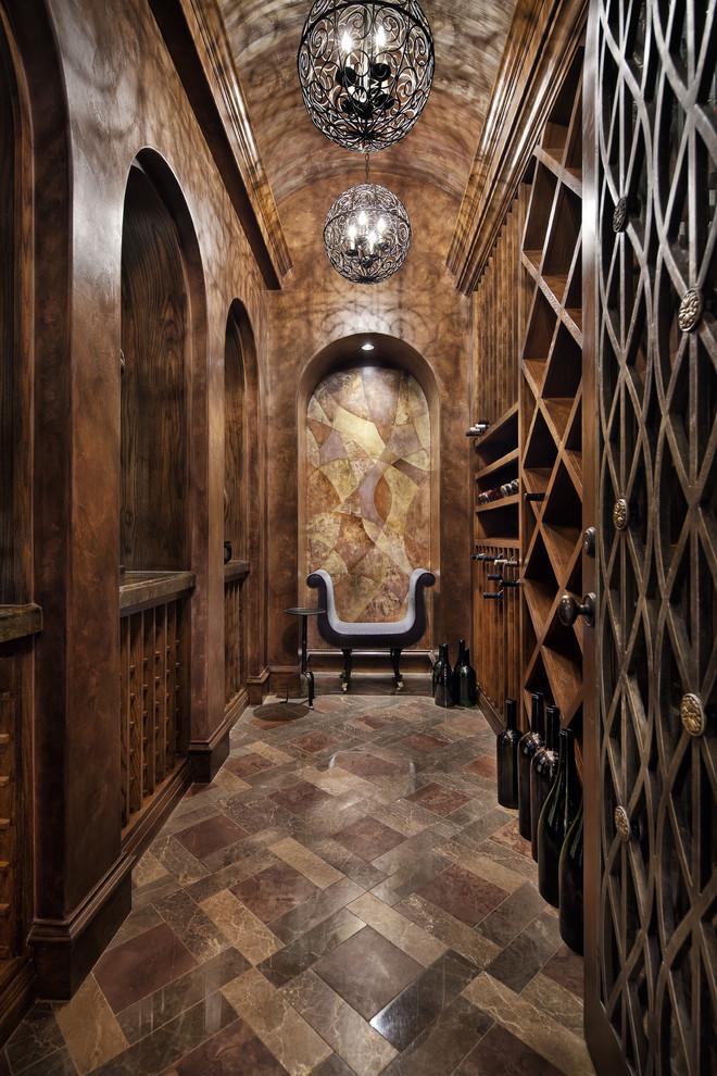 Wine cellar - mediterranean brown floor wine cellar idea in Dallas with diamond bins