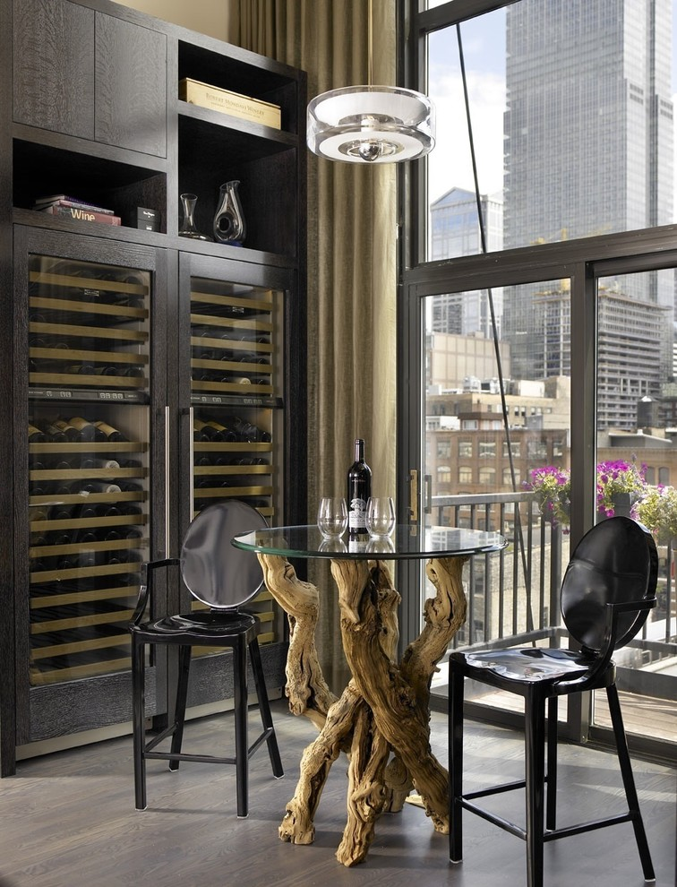 Inspiration for an industrial gray floor wine cellar remodel in Chicago with storage racks