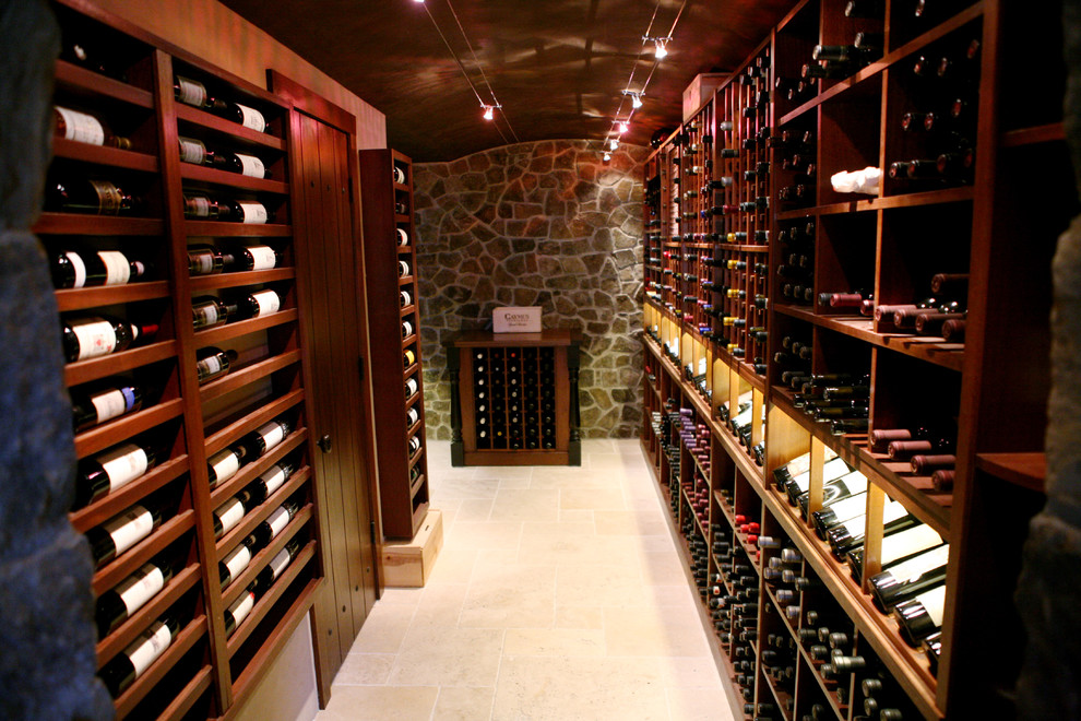 Elegant wine cellar photo in Other with display racks