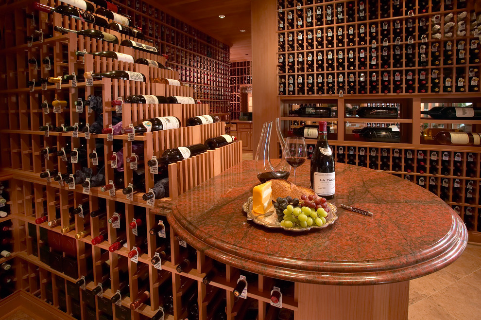 Wine cellar - large traditional ceramic tile wine cellar idea in Los Angeles with display racks