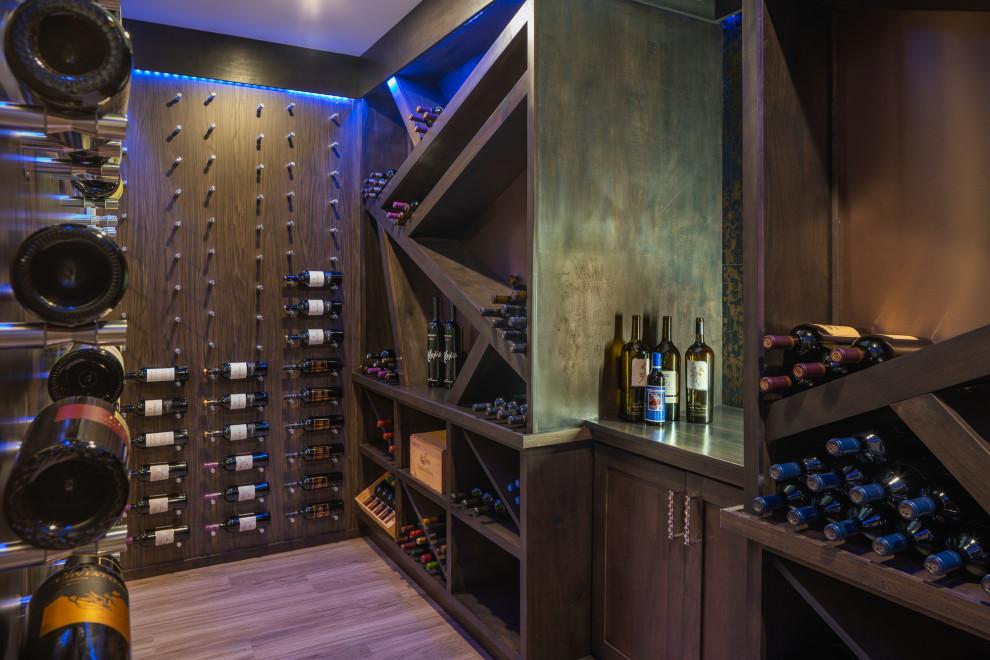 Example of a trendy brown floor wine cellar design in Cincinnati with display racks