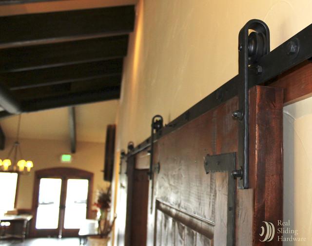 Wine Cellar Sliding Barn Door mediterranean-wine-cellar