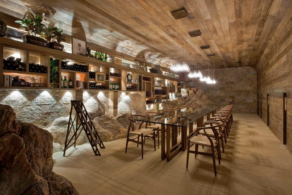 Huge island style beige floor wine cellar photo in Other