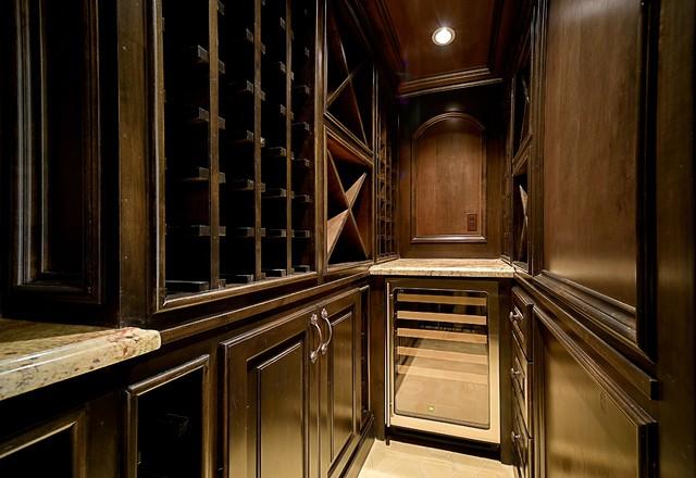 Wine cellar - traditional wine cellar idea in Houston