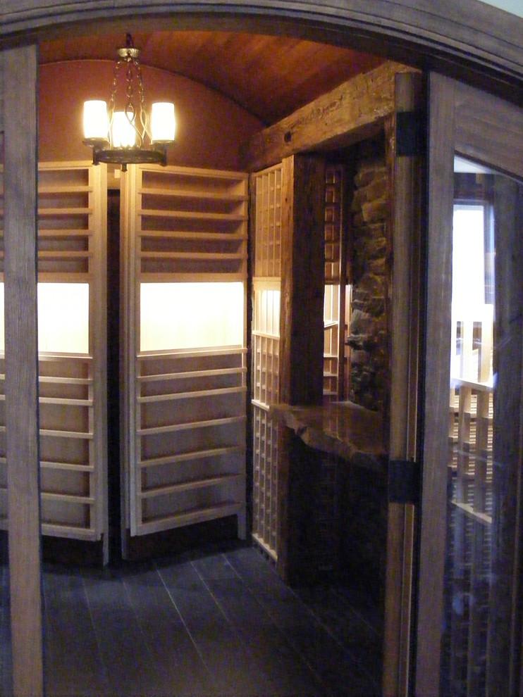 Wine cellar - traditional wine cellar idea in Toronto