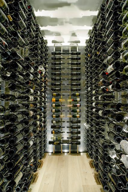 Mid-sized trendy light wood floor wine cellar photo in Vancouver with display racks