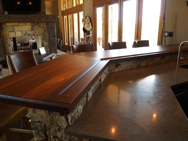 Rustic Gun Room in Texas highlights Texas Walnut Wood Tops rustic-wine-cellar