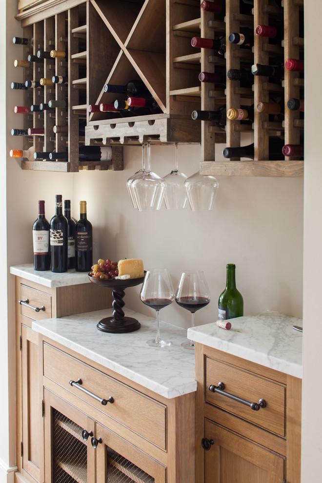 Small beach style wine cellar photo in New York
