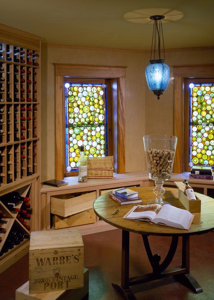 Wine cellar - traditional brown floor wine cellar idea in Boston with display racks