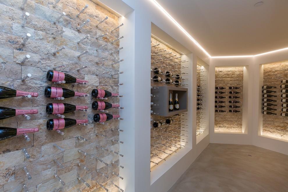 Example of a trendy beige floor wine cellar design in San Diego with storage racks