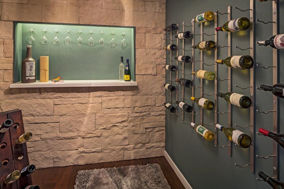 Contemporary wine cellar in San Francisco with dark hardwood floors and display racks.