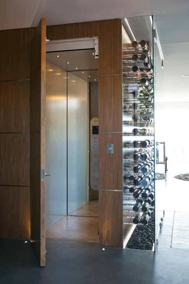 Inspiration for a contemporary concrete floor and gray floor wine cellar remodel in Vancouver