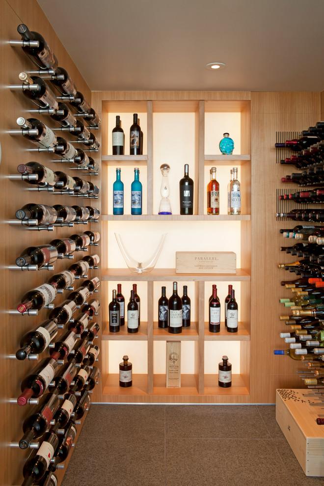 Wine cellar - small contemporary wine cellar idea in San Diego with storage racks