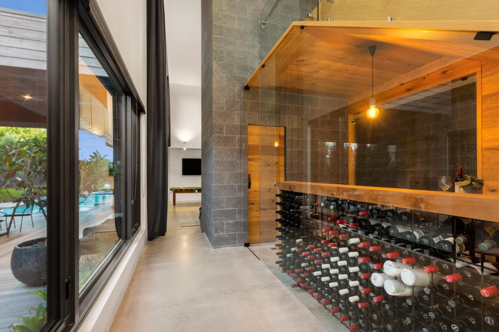 Design ideas for a contemporary wine cellar in Melbourne.