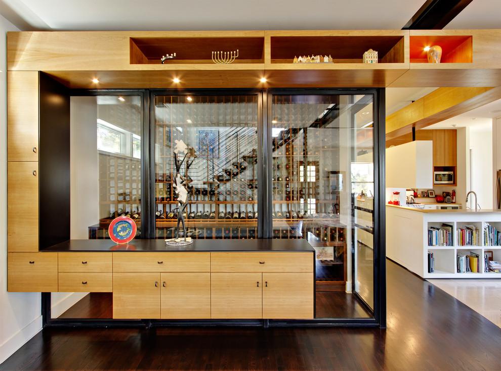 Example of a small minimalist dark wood floor and brown floor wine cellar design in Austin with storage racks