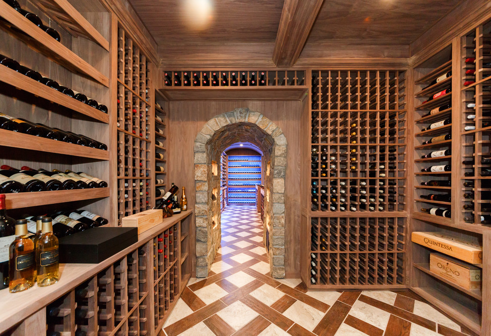 Inspiration for a huge mediterranean porcelain tile and brown floor wine cellar remodel in New York with storage racks