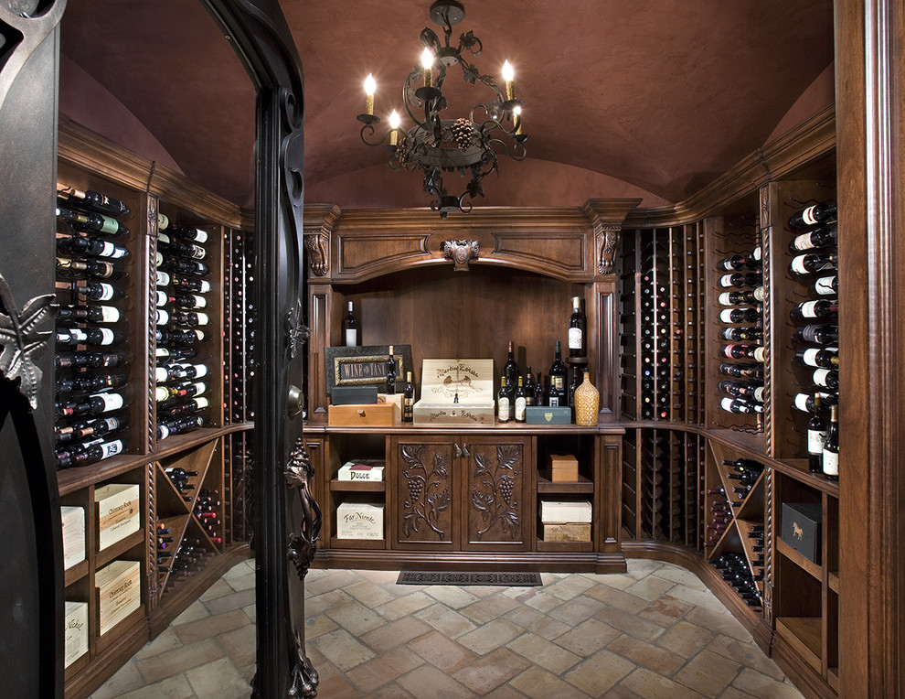 Example of a mountain style multicolored floor wine cellar design in Phoenix with storage racks