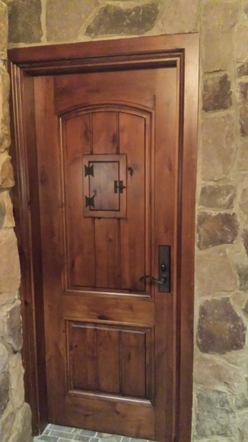 Wine cellar door tuscan style with speakeasy door for Mediterranean style entry doors