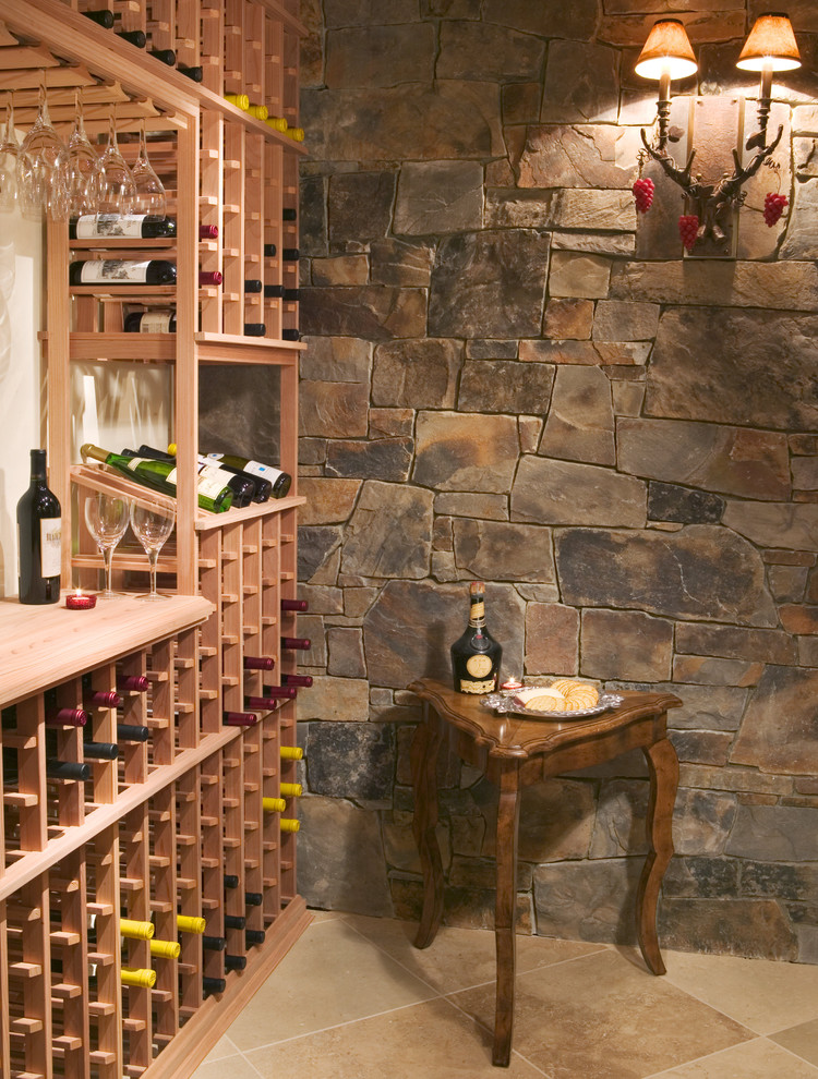 Example of a mountain style wine cellar design in Minneapolis with storage racks