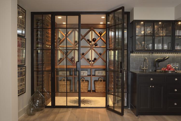 Wine cellar - contemporary medium tone wood floor and yellow floor wine cellar idea in Minneapolis
