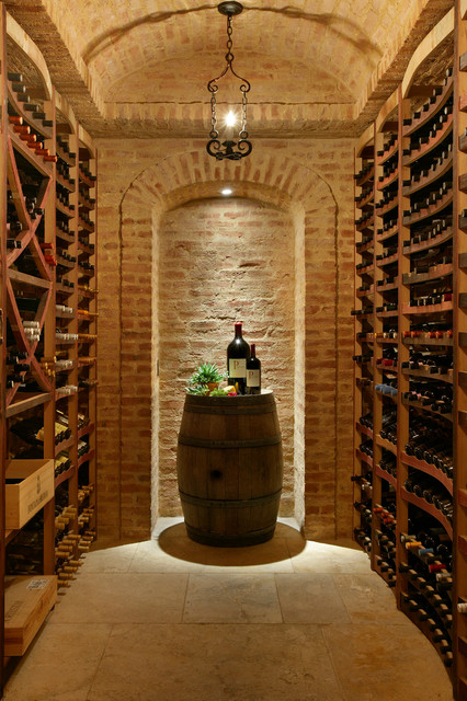 Wine cellars in stone mediterranean wine cellar new for Home wine cellar designs