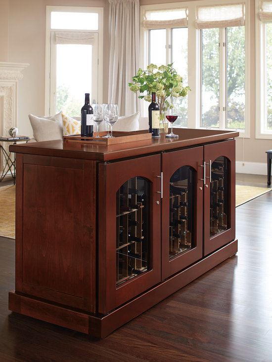 Wine Credenza Island in Classic Cherry - Our credenza island is completely finished on all sides, with hidden vents, for a completely clean presentation that can be placed anywhere you need! Clean, contemporary design blends equally well with modern, Craftsman, Deco or Asian decors. Hardwood doors and gently arched windows showcase fine wine collections. Sealed seams, premium insulation and tinted double-paned glass provide thermal and UV protection.