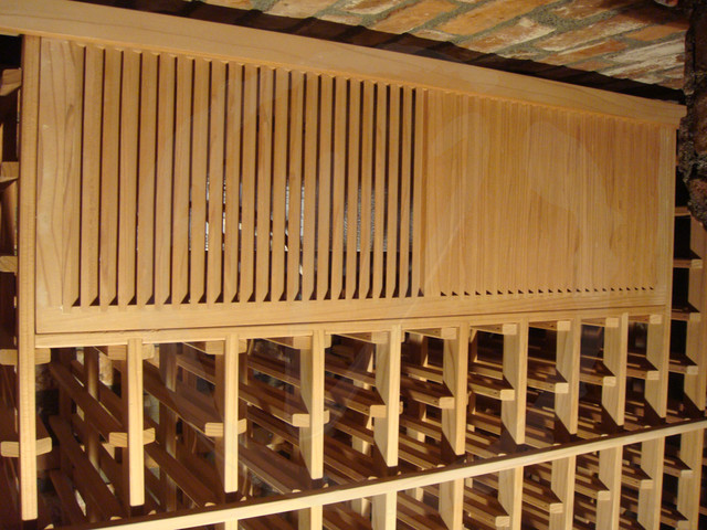 Wine-Mate Cooling System is Concealed by a Custom Wood Grille traditional-wine-cellar