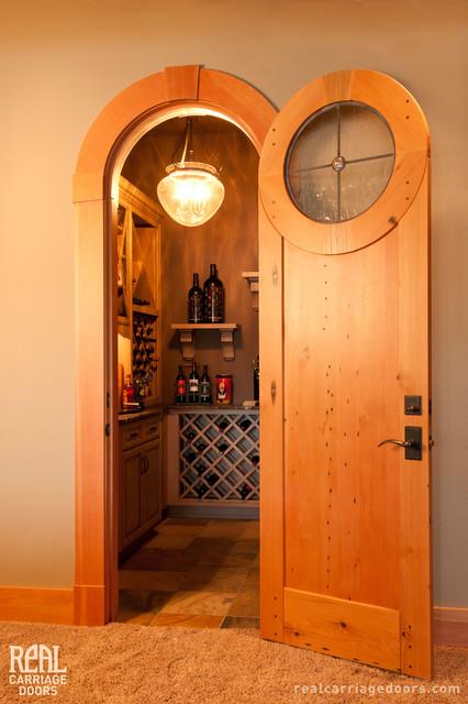 Wine room nautilus door eclectic wine cellar for Garage wine cellar